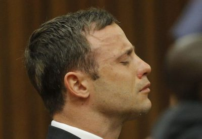 South African paralympian athlete Oscar Pistorius listens on September 11, 2014 as a judge began at the High Court in Pretoria handing down her verdict on whether he was guilty of the 2013 Valentine's Day murder of his model girlfriend. Judge Thokozile Masipa moved swiftly into her assessment of the almost 40 witnesses, apparently rejecting state evidence that pointed to an argument between the couple. The judge also found that Pistorius was not guilty of the premeditated murder of girlfriend Reeva Steenkamp, dismissing the most serious of charges against him.               AFP PHOTO / POOL / KIM LUDBROOK