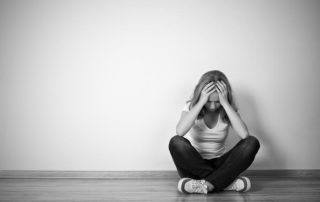 bigstock-girl-sits-in-a-depression-on-t-52227706-700x484