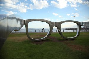 Michael Elions polycarbonate artwork of Sunglasses, dedicated to Nelson Mandela, at Sea Point, Cape Town. The piece controversially co-funded by Ray-Ban is considered to be in poor taste by some. Image Jayne Haywood. 21.03.15